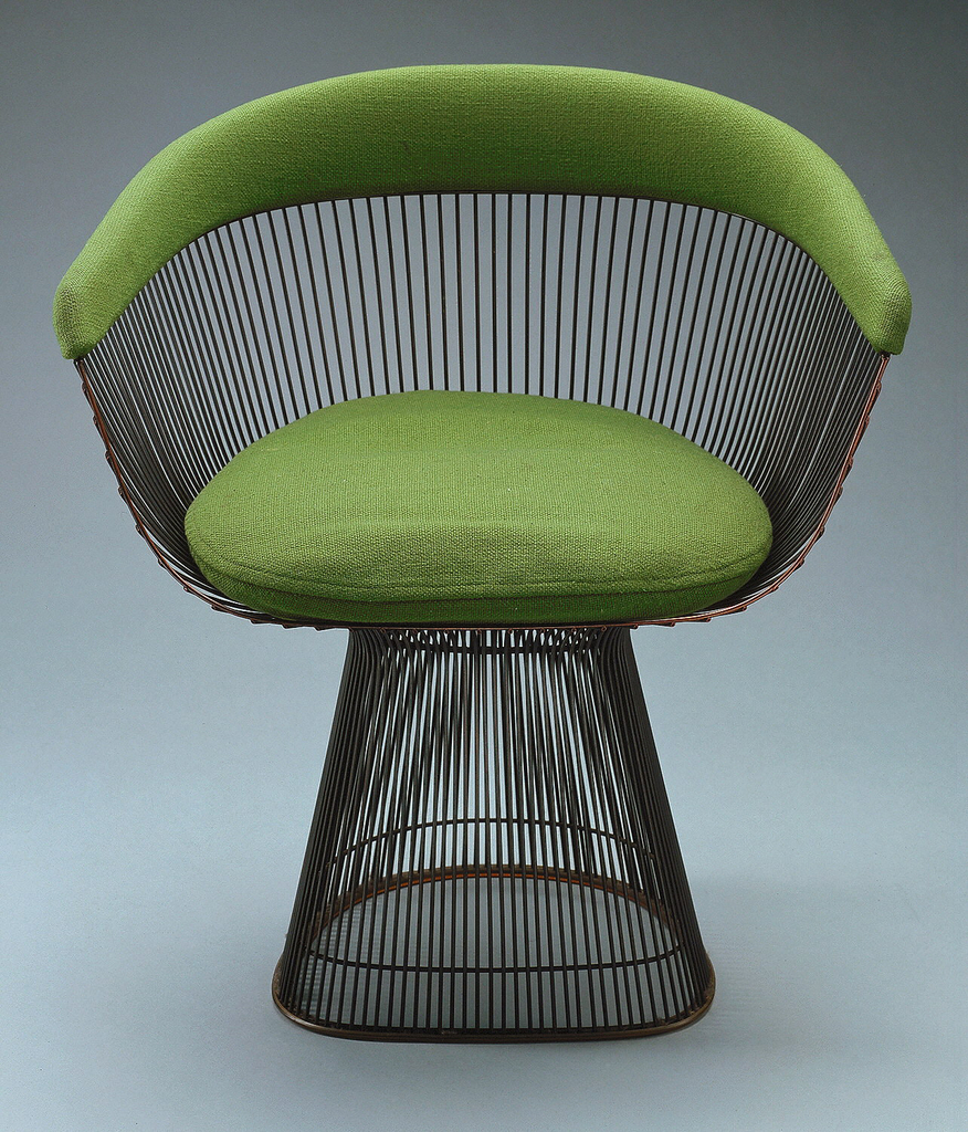 Welded wire form comprising bucket-type seat on conical base; back/arms with band of green uhpholstery; green seat cushion.