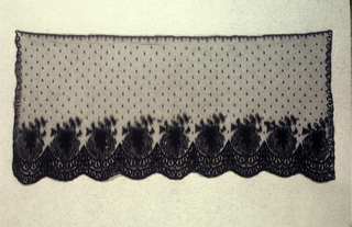 Repeating scalloped border with large leaf set into each scallop along the bottom edge. Motifs are embroidered in a chain stitch onto a net ground. Narrow scroll along remaining three edges and dotted field.