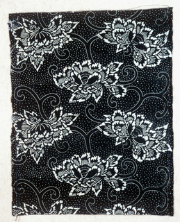 Chrysanthemums on a vine on a dark blue background scattered with tiny white dots. Rice paste stencil resist and printed with indigo.
