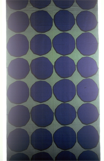 Design of circles with irregular contours in dark blue on green ground.