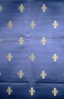 Rosettes in gold on a blue background.