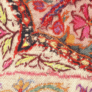 """Square woven shawl with a red ground and multicolored design in pink, orange, green, blue, purple, and white.  A taupe eight-pointed star in the center is surrounded by snake-like forms. From each corner, a yellow pine cone form set on an elaborate vase points toward the center; between these is a smaller, purple cone. An inner guard boder has a repeating design of alternating flowers, and the outer """"harlequin"""" border is of bands of alternating color. All pattern areas are filled with tiny plants and flowers."""