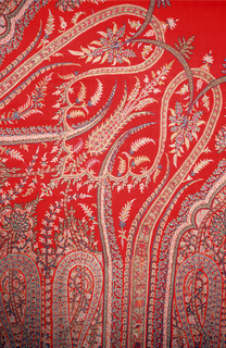 Red shawl with a dense arrangement of elongated paisley and floral motifs.