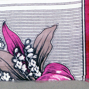 Quarter of a printed scarf in magenta, tan, and black. Field is undyed and border shows lily of the valley on striped ground.