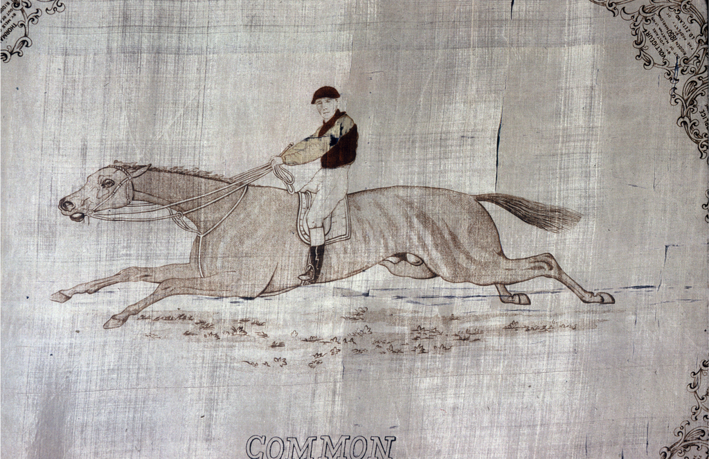 Silk handkerchief printed with a picture of an equestrian in brown on cream. Surrounding are many small cartouches enclosing information about the winning horses os each year. Text along the border reads: WINNERS OF THE DERBY FROM THE COMMENCEMENT IN 1780. Printed below the horse: COMMON/ by Isonomy - Thistle / Winner of the Derby / Trained by J. Porter 1891 Ridden by G. Barrett / The property of Sir F. Johnstone. Red border. Hemmed on the two ends