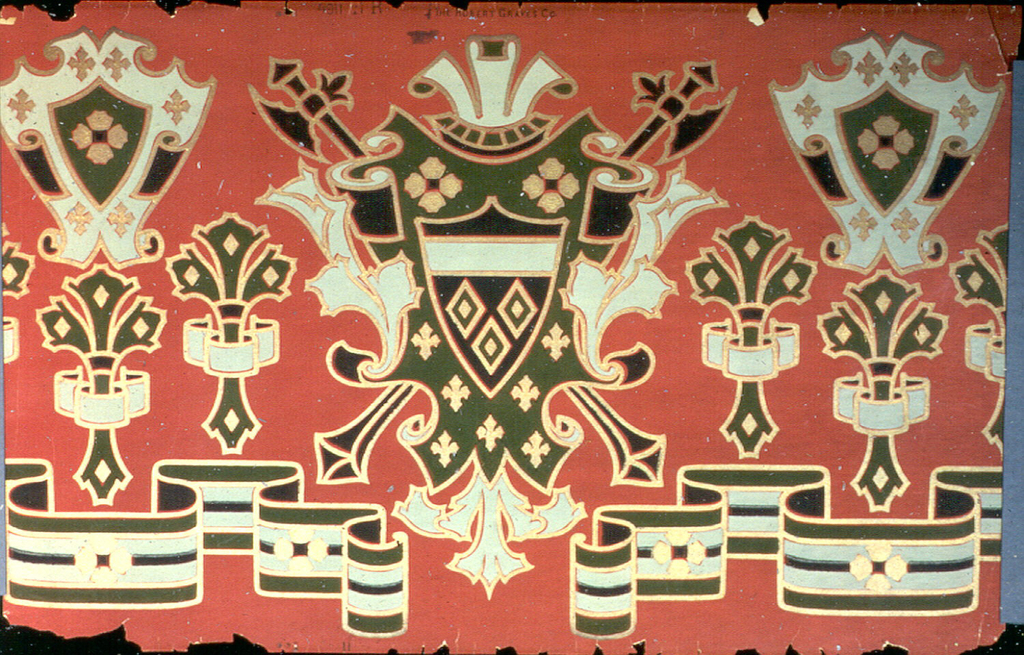 Large-scale coats of arms on shield, alternating with fleur de lis. Below this is a folded ribbon motif. Printed in black, white and gold on bright red ground.