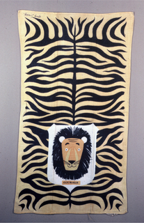 """Head and skin of a lion, with """"Courage"""" printed under the lion's head. In black, orange and yellow."""