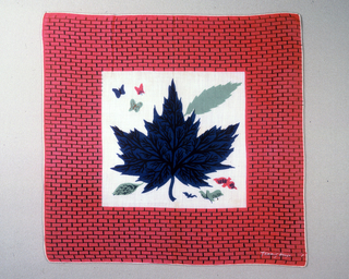 Oak leaf, butterflies and birds, printed in black, blue, green and red. Border with a brick pattern.