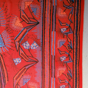 Bright red chiffon printed with a bold linear interpretation of an exotic floral pattern. Wide guard border on right side contains angular geometric floral forms while the left side has a narrow striped border. Three verses scattered throughout the floral pattern: 1) O long, long stems that twine; O buds so neatly furled; O great white ells of mine; (None purer in the world); 2) Scilla, Scilla, tell me true; Why are you so very blue; Oh, I really cannot say; Why I'm made this lovely way; 3) Crocus of yellow, new and gay; Mauve and purple in brave array; Crocus white like a cup of light.