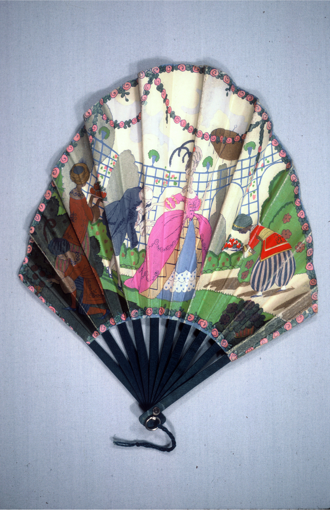 "Pleated fan with arched shape double leaf. Obverse: polychrome printed paper (possibly letterpress) with man and woman in eighteenth century costume in a garden attended by three servants. Reverse: printed paper with vase of roses surrounded by swags of roses and printed with advertising ""Plaza, Paris."". Wood, sticks painted blue. Metal bail at rivet."