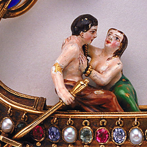 Gold and enamel jeweled brooch in the Renaissance style in the form of a ship with two lovers in stern and two doves in the prow; with four button pearls, five half-pearls, six rubies, eleven emeralds, four sapphires, eleven rose diamonds.