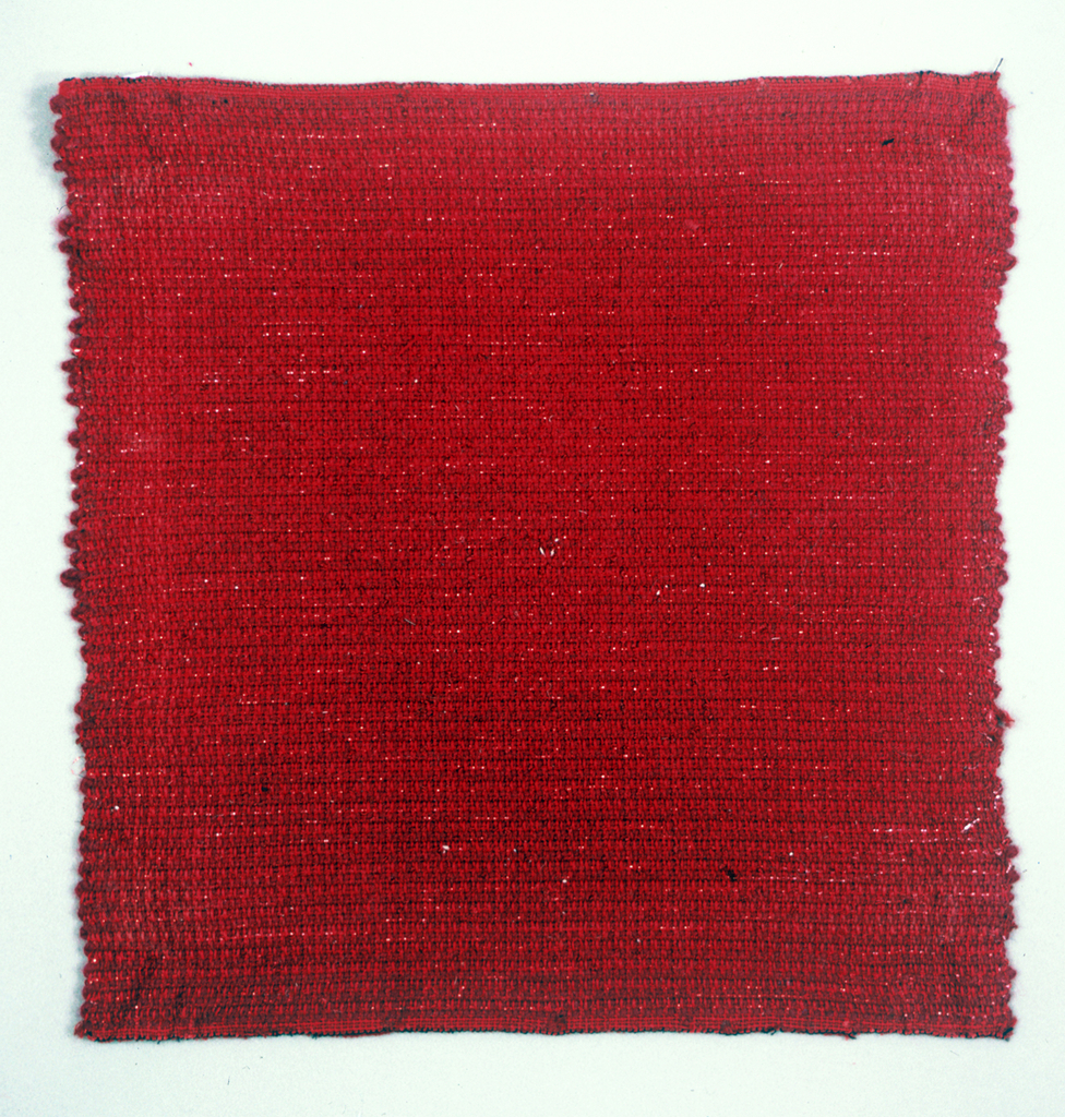 Hand woven sample in red textured fabric is a variety of yarns.