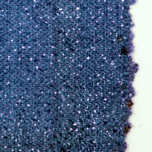Hand woven sample of medium blue fabric with flecks of metallic.