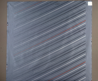 Diagonal lines in grey, black, white and red on a grey background.