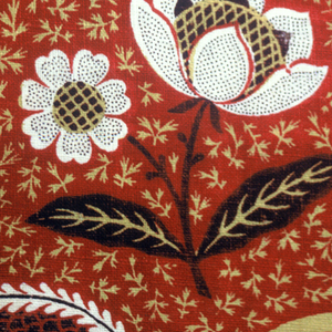 Diamond lattice enclosing floral sprigs in red, yellow and white. This is a very good copy of a Jouy design. On the Jouy fabric the floral veins are in lines; here they are scattered dots.