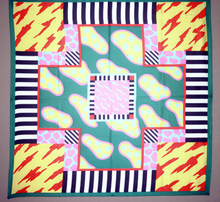 Abstract cloud-like pattern in bright colors set in squares with interspaces filled with other patterns.