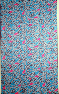 Dress fabric showing blob-like shapes in fuchsia and medium blue on a background of mottled gray and navy.