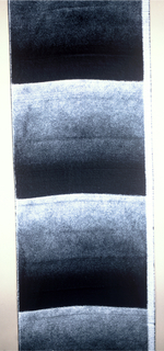 Length of pile fabric with very wide horizontal bands of black-to-white ombre effect.