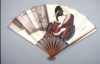 """Pleated fan. Stiffened silk leaf painted in the in 'Ukiyo-e"""" style with the female figure of an artist sitting before a folding screen. Bamboo sticks."""
