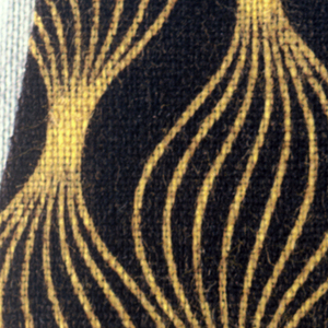 Stripes of fine line which open in balloon-like shapes then close in yellow on brown.