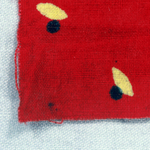 Yellow ellipses and brown dots on bright red background.