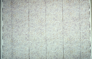 "Texture of irregular dots ""smudged"" diagonally, fault lines as in marble divide the design vertically."