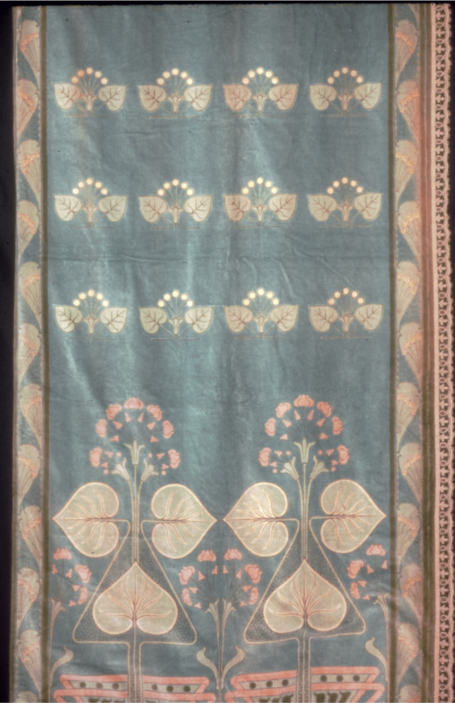 Curtain panel with an aquamarine ground printed in a design of water lilies. The top half of the panel has four rows of smaller detached sprigs with leaves. The bottom half shows a pair of larger water lilies emerging from a stylized vase shape. Border is comprised of sprigs inside a balloon-like shapes.