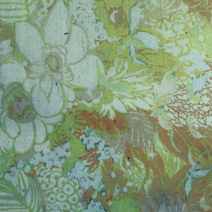 Sheer orange fabric with tropical floral design in yellow with touches of light blue.