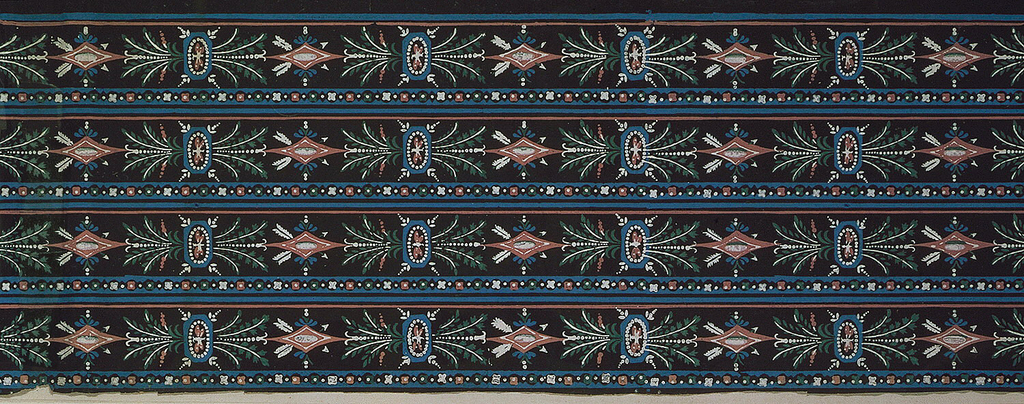 Four bands of a border design printed across the width. Each band consists of a wide central strip containing dragonflies framed by octagonal, beaded shapes with attached sprays of foliage alternating with lozenges pierced by two arrows. Above this strip is a band of simple floral motifs (quatrefoil) alternating with diamonds, all these punctuated by a center dot. Below the wide central strip are two narrow stripes. Printed in blue, mauve, green and white on a black ground. H# 515