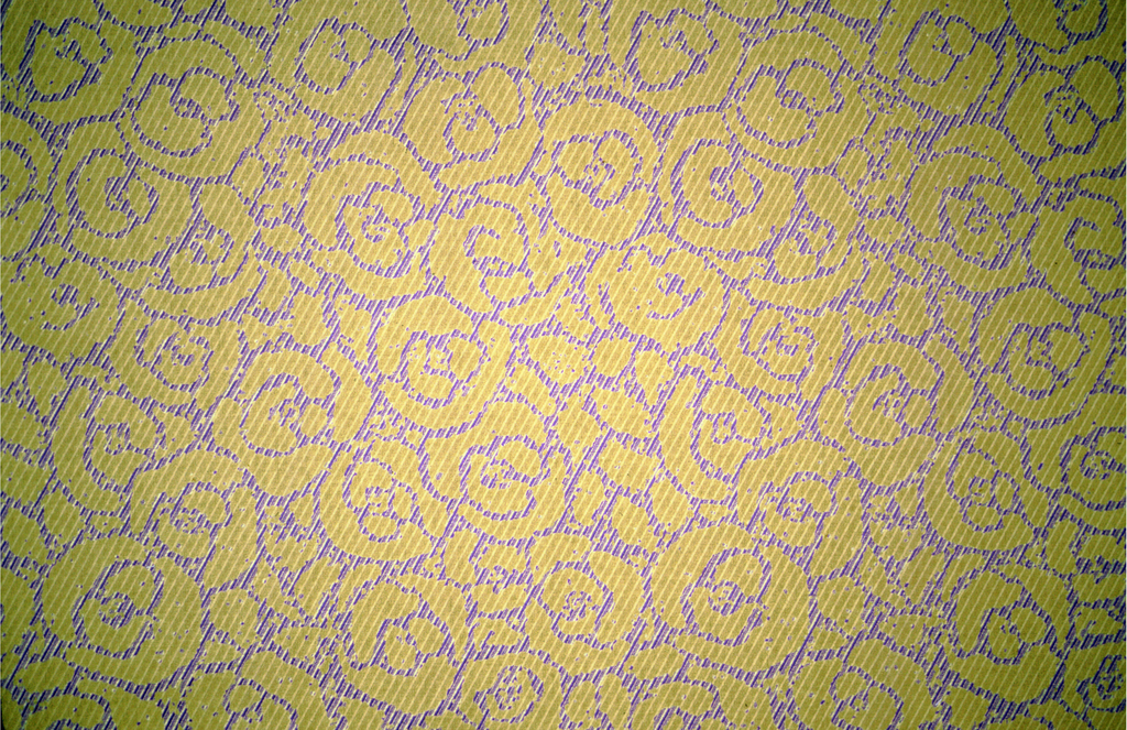 Abstract rose pattern printed on a purple and yellow diagonal weave