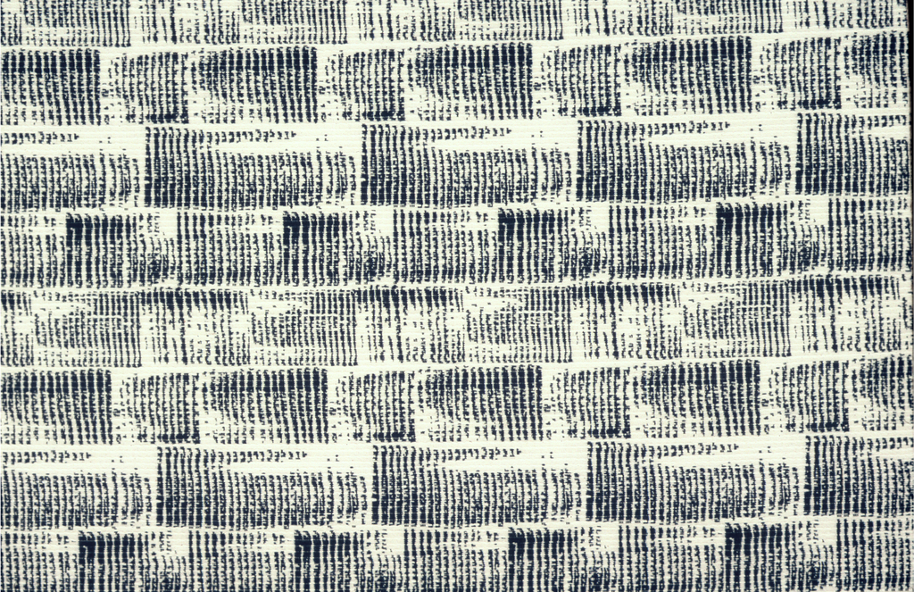 Blue and white reversible fabric with a woven design simulating a repeatingbrushstrokes which form a continuous texture