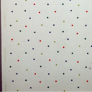White fabric with brightly colored circles with burnt out centers.