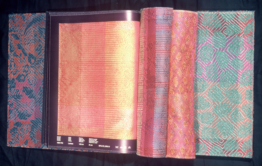 Book containing 31 pages of samples of fabric in 12 different patterns.