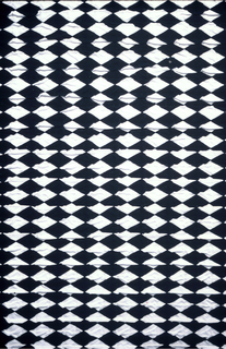 Puckered black and white diamond pattern.