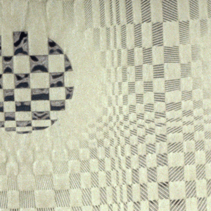 Circles of checkerboard in a larger optical grid. Gray on black. The Minafoam creates a textured surface.