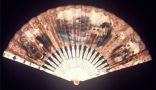 Pleated fan. Printed paper leaf showing three large cartouches upon a scrolling ground; at center, a scene with royal barges on a river; at left, a woman on her knees mourning; at right,  a queen with attendants. Drilled bone sticks with metallic foil. Mother-of-pearl at rivet.
