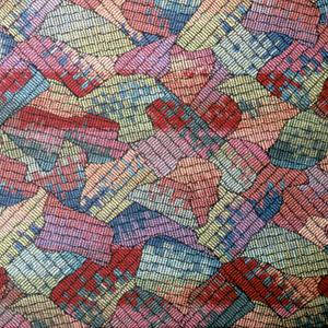 Multicolored interlocking shapes.