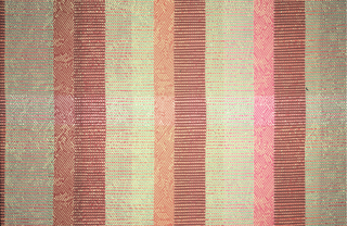 Complex vertical stripes printed on a jacquard woven ground with a diamond pattern created by shiny viscose wefts.