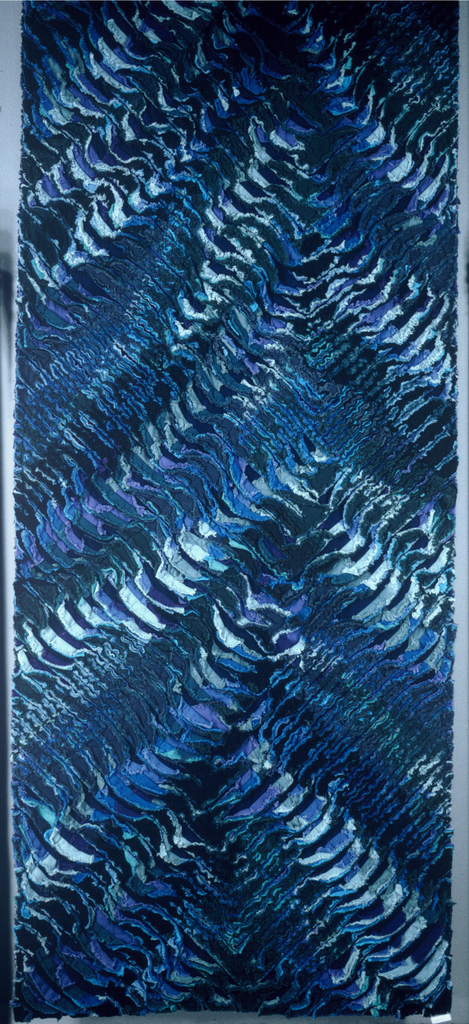 Zigzag design in blue, green and purple with pile effect caused by fraying of appliqued strips