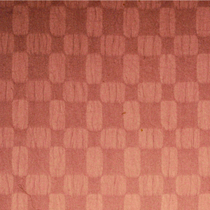 Length of woven cotton with a checkerboard pattern of puckered squares, in rusty brown.