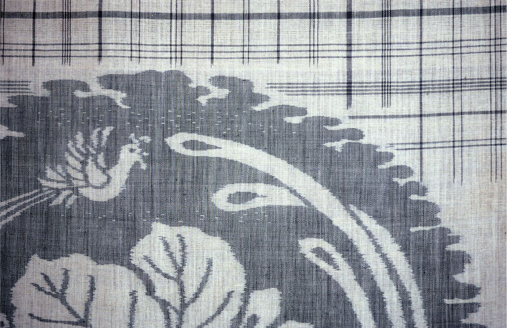 Circular shape of long tailed birds and paulownia with band of plaid. Blue and off-white.