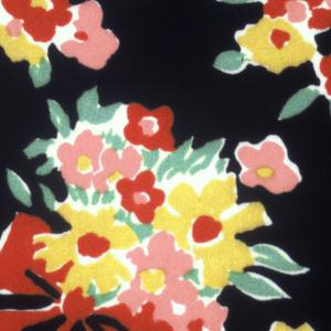 Baskets of multicolor flowers on black.