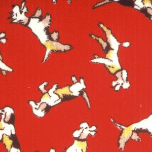 Dogs in black, yellow, white and beige on red.