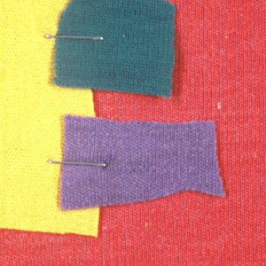 Four pieces of monchrome fabric stapled together.