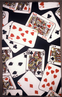 Brightly colored playing cards on black background.