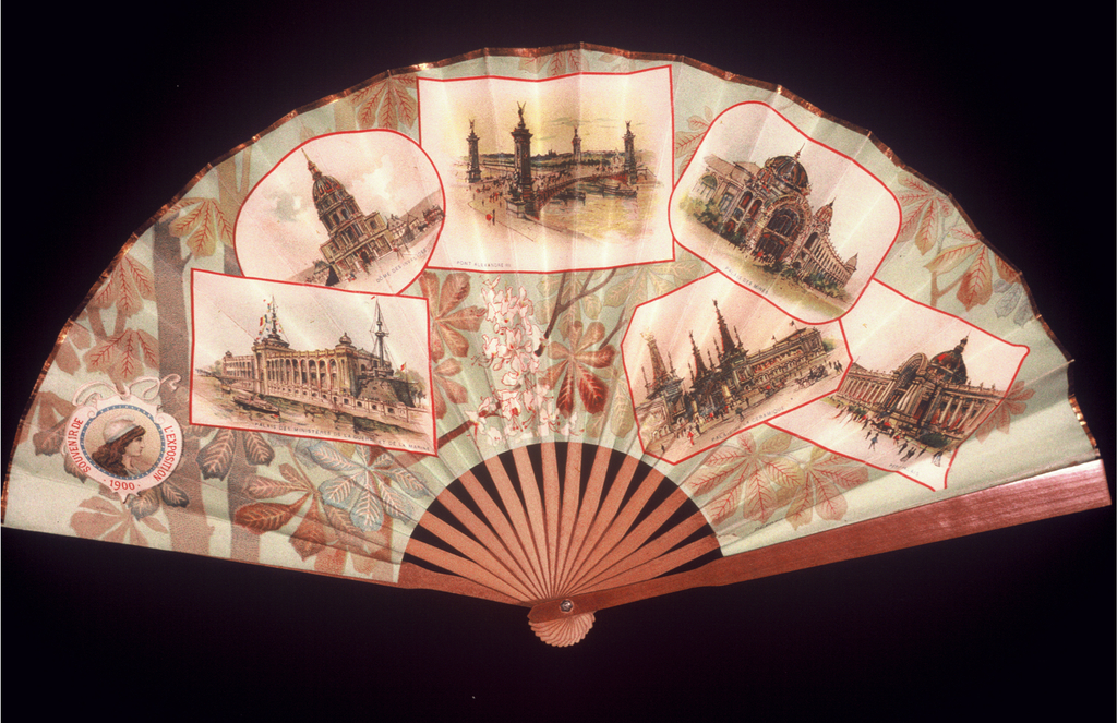 Pleated fan created as a souvenir for the 1900 Exposition in Paris. Printed paper leaf showing overlapping images of Paris monuments including the Petit Palais, which had been built for the Exposition. Wood sticks.