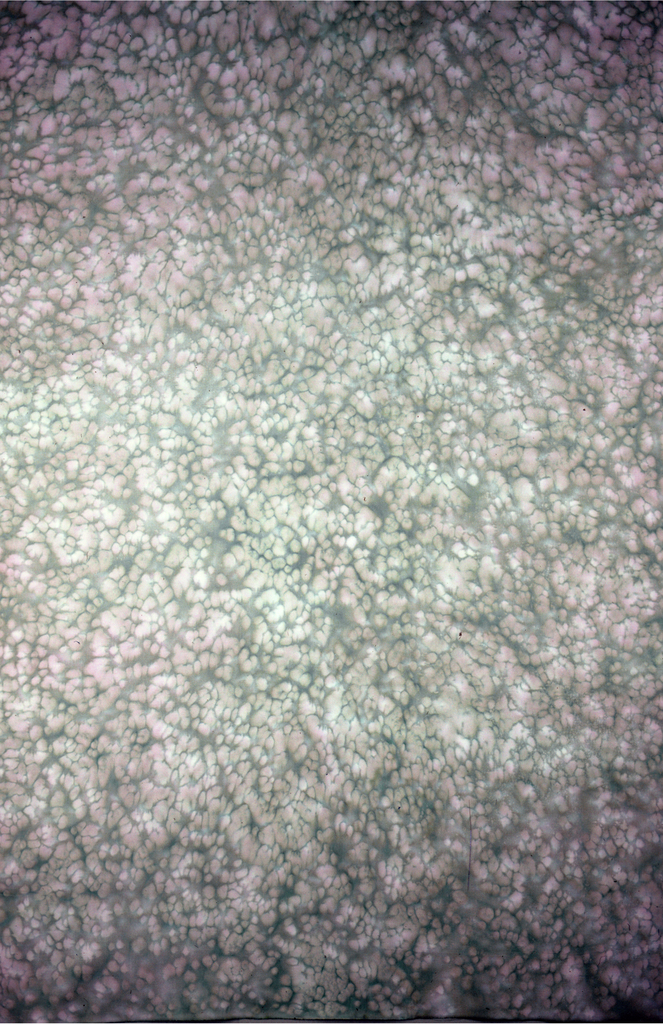 """Splotchy effect of pink dots on brown. Company calls color 'Birch""""."""