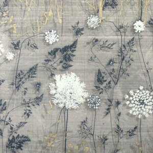 On a gray ground, a pattern of white dandelions and other wild plants in yellow and dark green, with shadow effect.