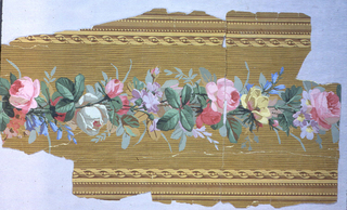 Floral band running down center, with a ribbon-twist on either side. Printed on a wood-grained ground.  H#240