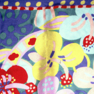 Bright blue scarf printed with brightly colored flowers.